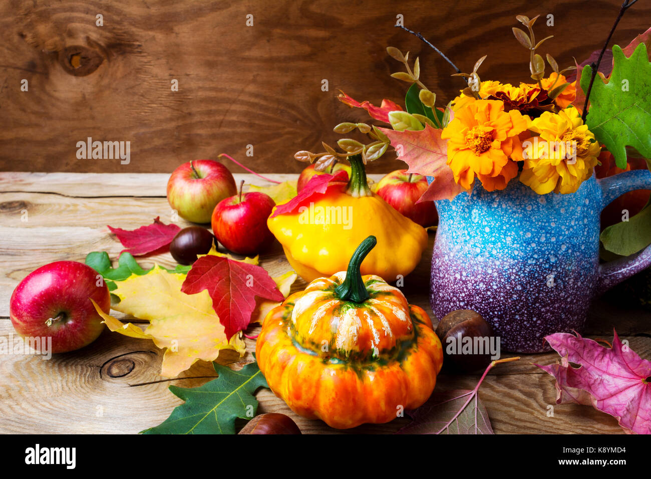 Rustic Thanksgiving Table Centerpiece With Apples Pumpkins And Marigold Flowers Fall Greeting Background Close Up
