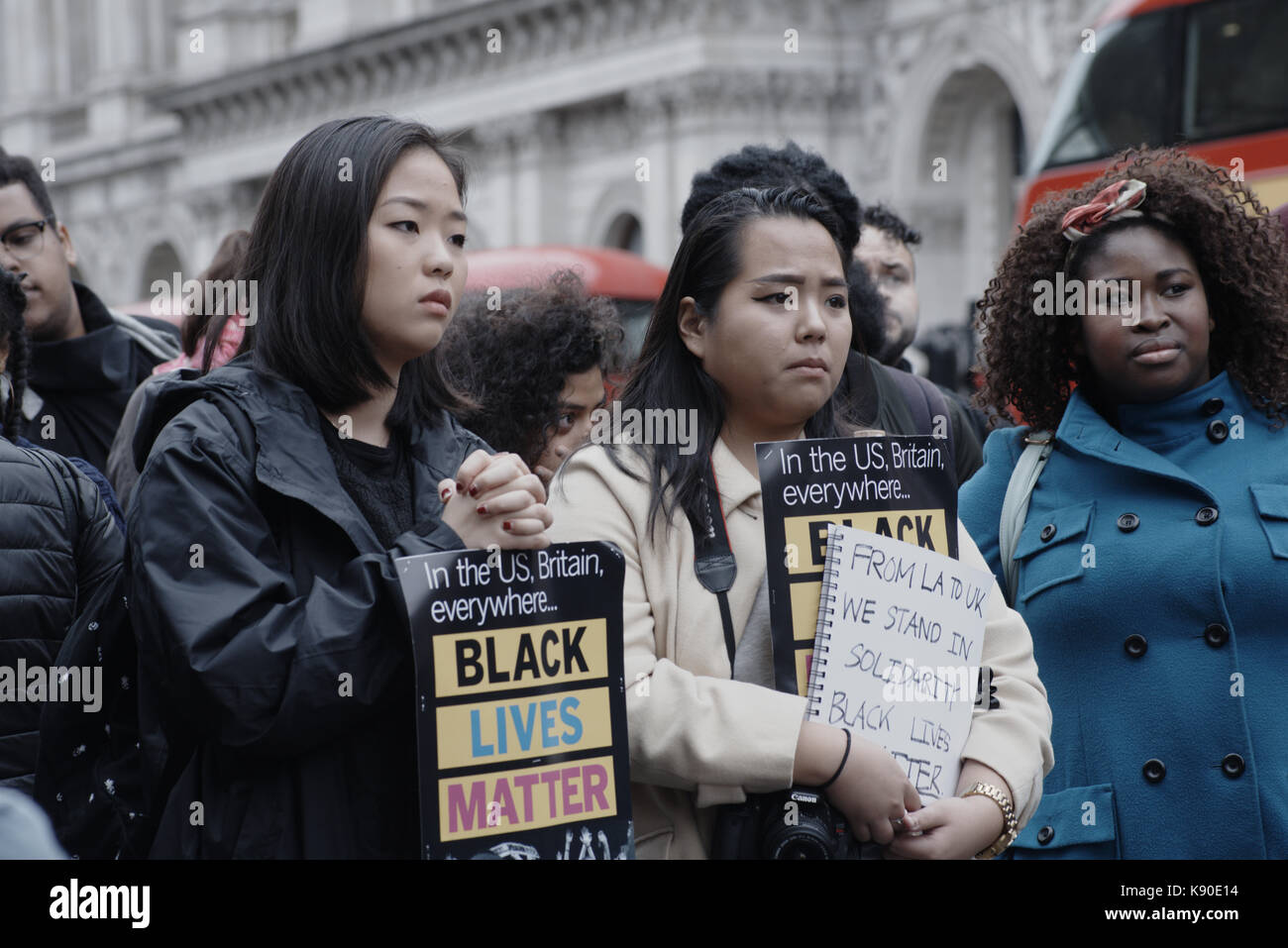 United Families and Friends annual demo against police violence and death in custody. Three girls hold Black Lives - Stock Image