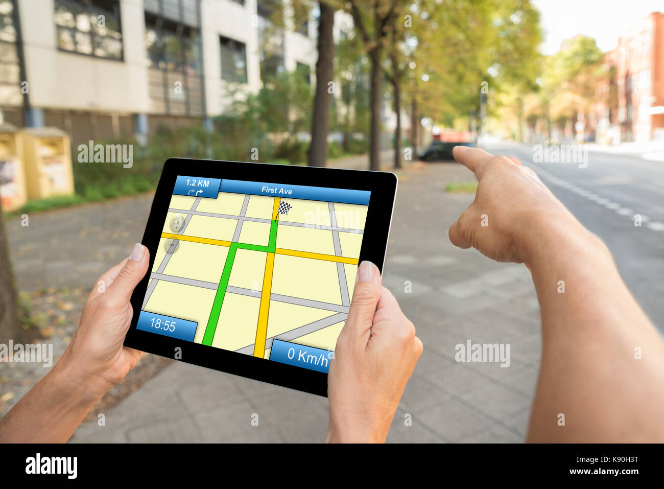 Close-up Of Two People Hands Using Gps Map Navigation On Digital Tablet - Stock Image