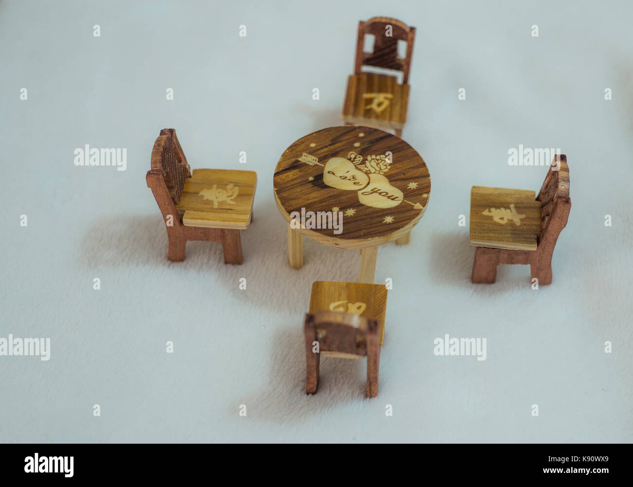 Miniature wooden table and chairs - Stock Image