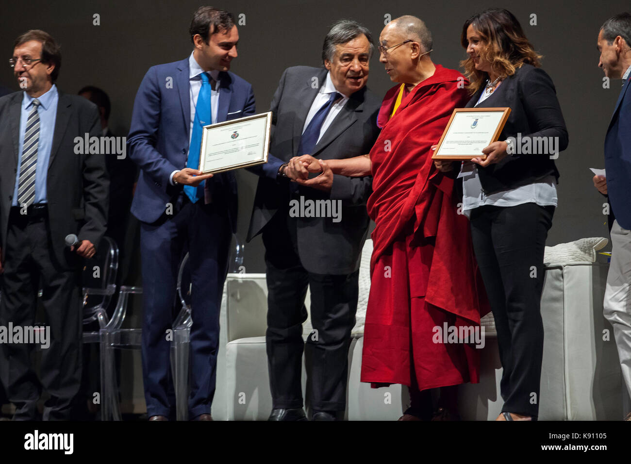 The XIV Dalai Lama takes to the stage to address the faithful in Palermo on September 18, 2017. Stock Photo
