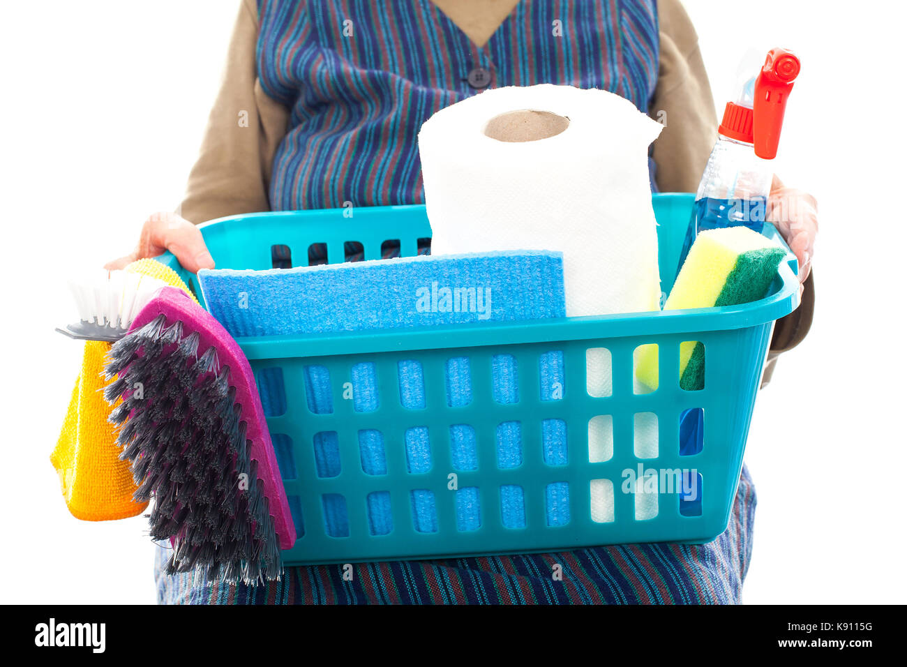 Close up of a senior lady doing housework holding cleaning equipment - Stock Image