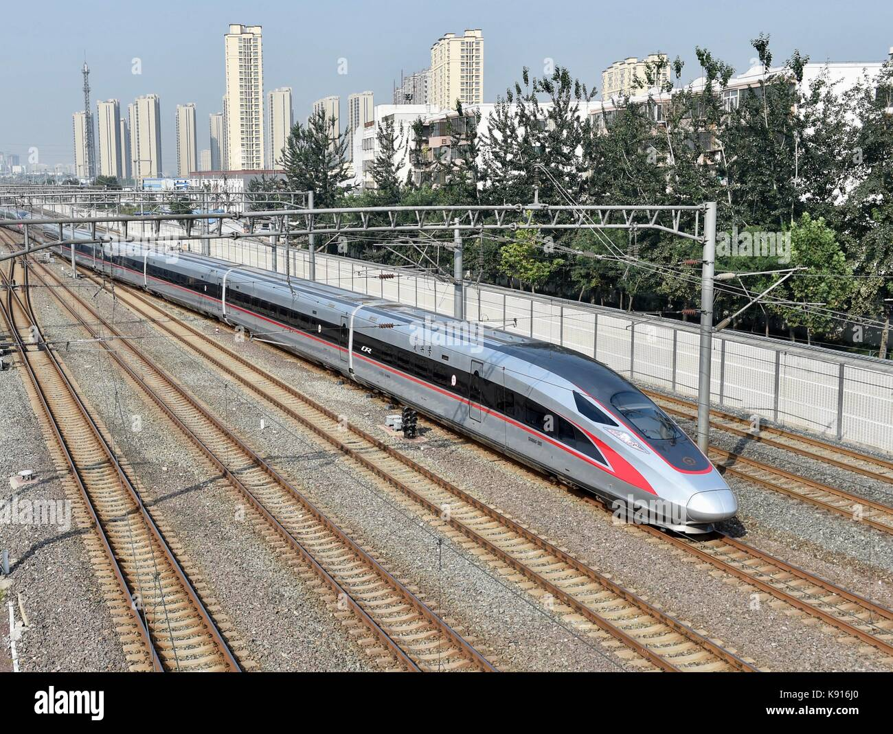 Beijing, China. 21st Sep, 2017. The G1 Fuxing bullet train leaves Beijing South Railway Station on the Beijing-Shanghai - Stock Image