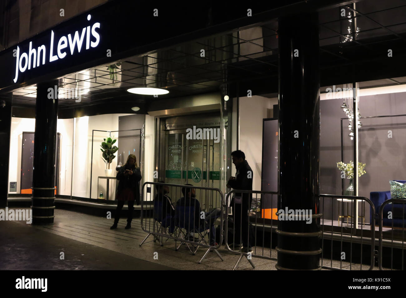 London, UK. 21st Sep, 2017. The first members of the public wait outside John Lewis, Oxford Street, London, UK, Stock Photo
