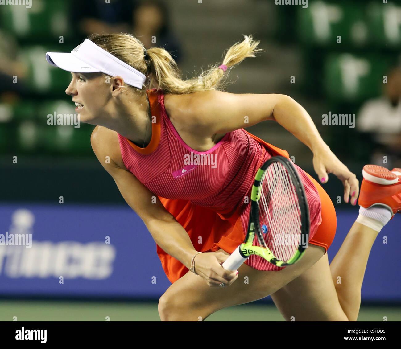 Tokyo, Japan. 21st Sep, 2017. Defending champion Caroline Wozniacki of Denmark delivers a service against Shelby - Stock Image