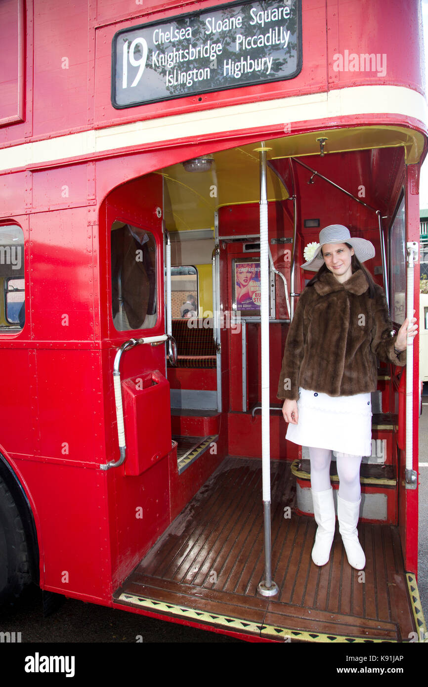 Woman in Furs and mini dress on London bus - Stock Image