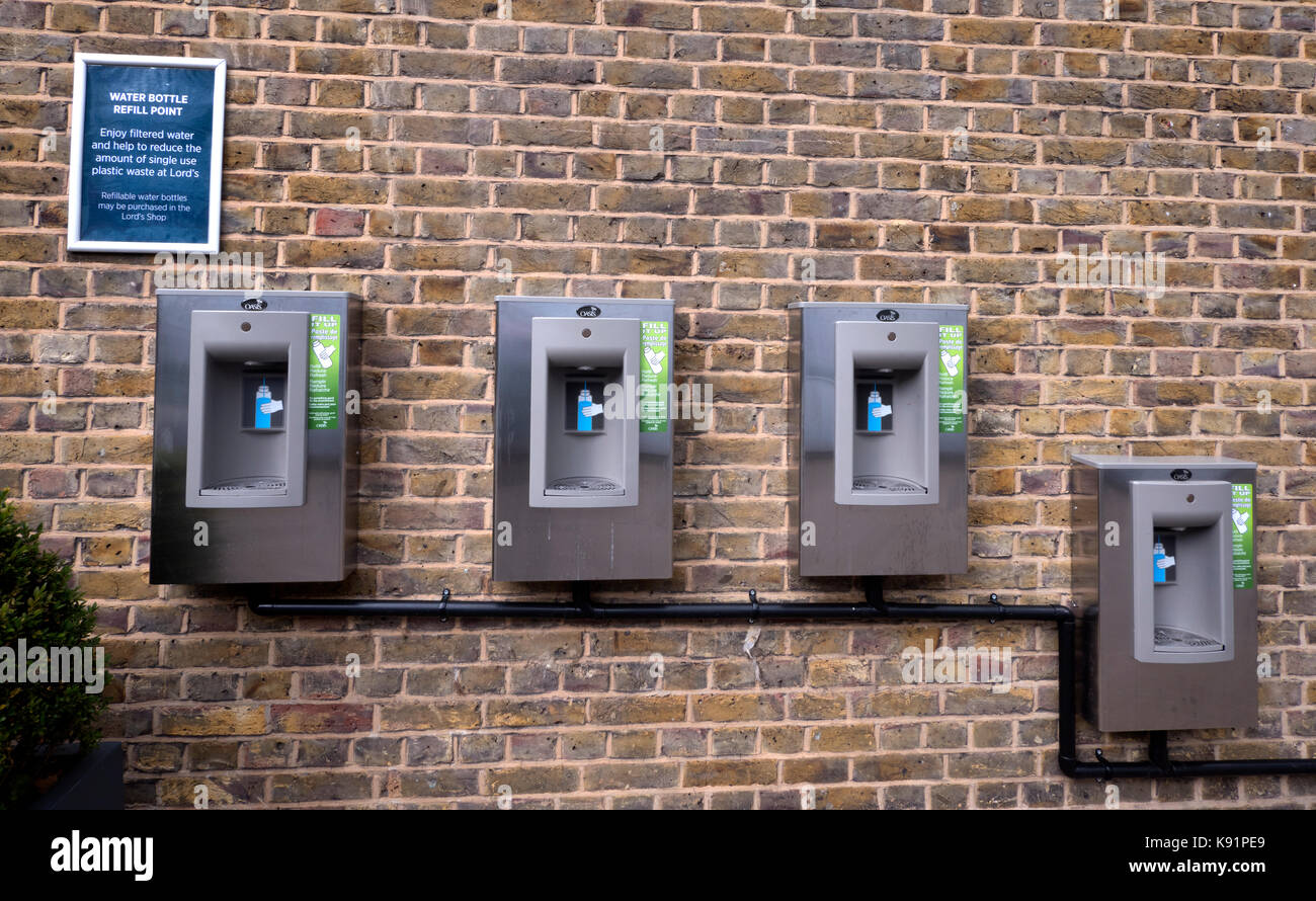 Modern water taps to supply drinking water to the public (water bottle refill) at Lords Cricket Ground, St Johns - Stock Image