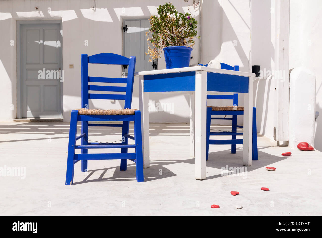 blue and white chair. Pretty Greek Island Scene Of A Whitewashed House With Blue Chairs And White Table In Chair