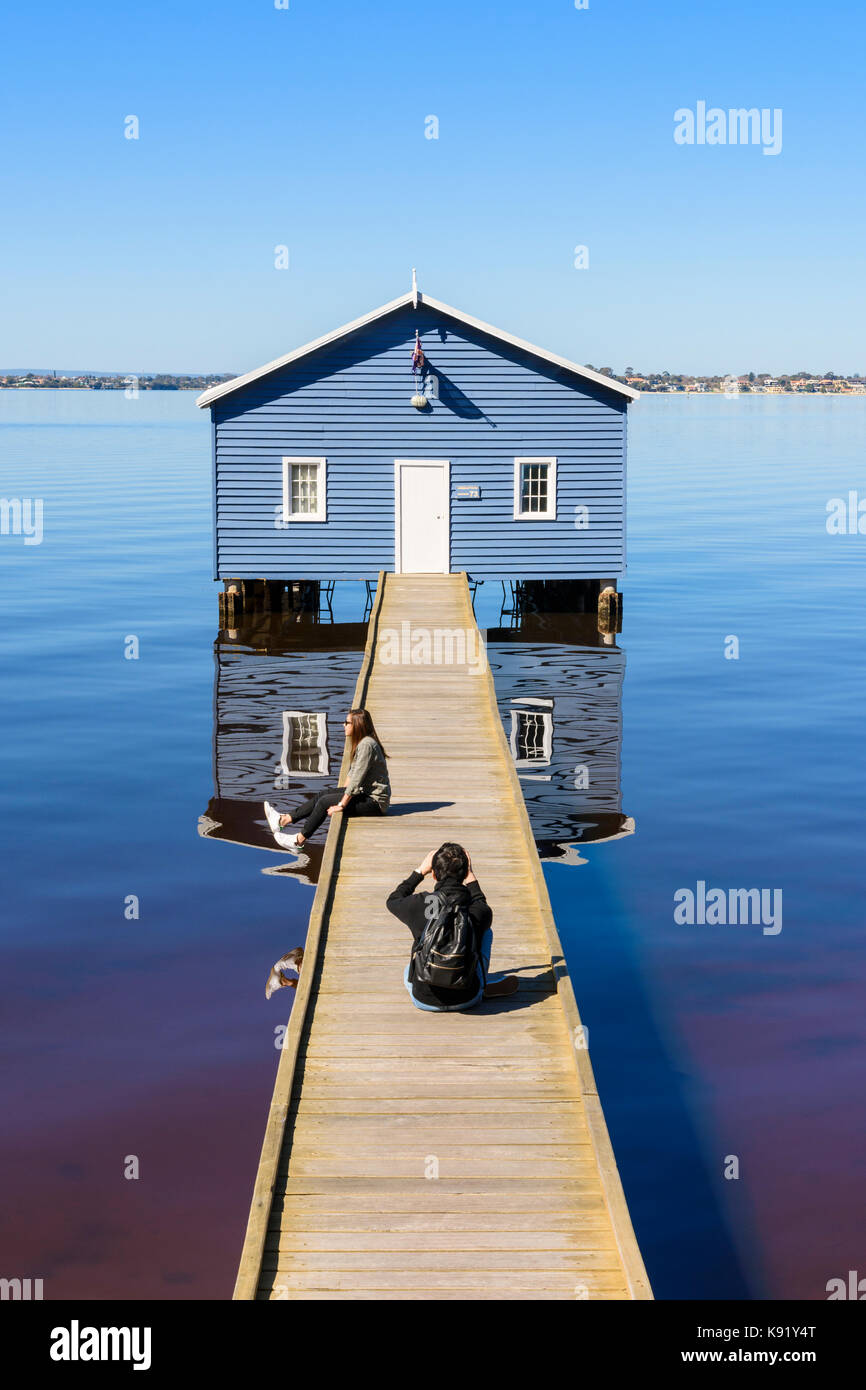 Tourists taking photos of the Crawley Edge Boatshed or Blue Boat House on the Swan River in Matilda Bay, Crawley, - Stock Image