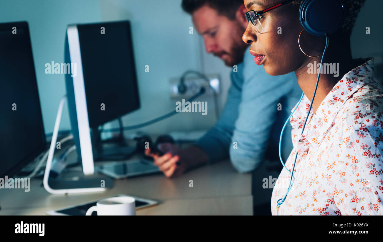 Portait of software designer working in office - Stock Image