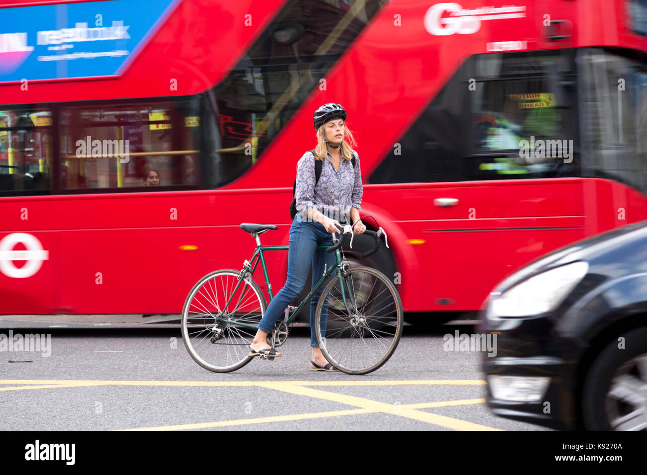 London, UK - August 19, 2017: London traffic is a threat for bicycle users - Stock Image