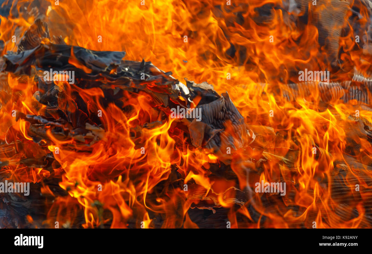 Heart of a raging fire at its most efficient, ashes in the fire show detail of what is burning. A business metaphor - Stock Image