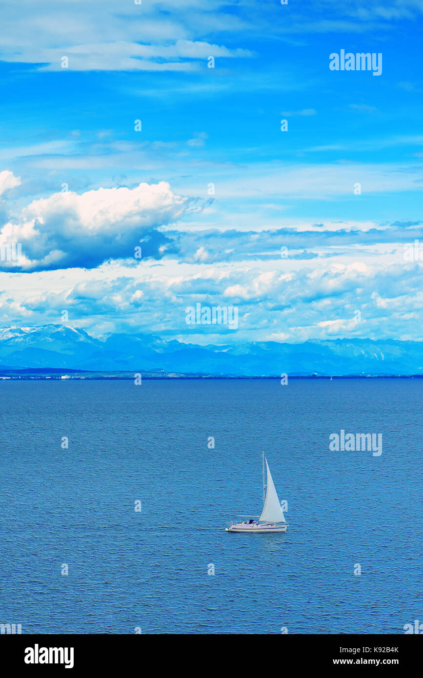 Sailing boat on seascape. Summer activity on sea. Seaside leisure time and enjoyment. - Stock Image