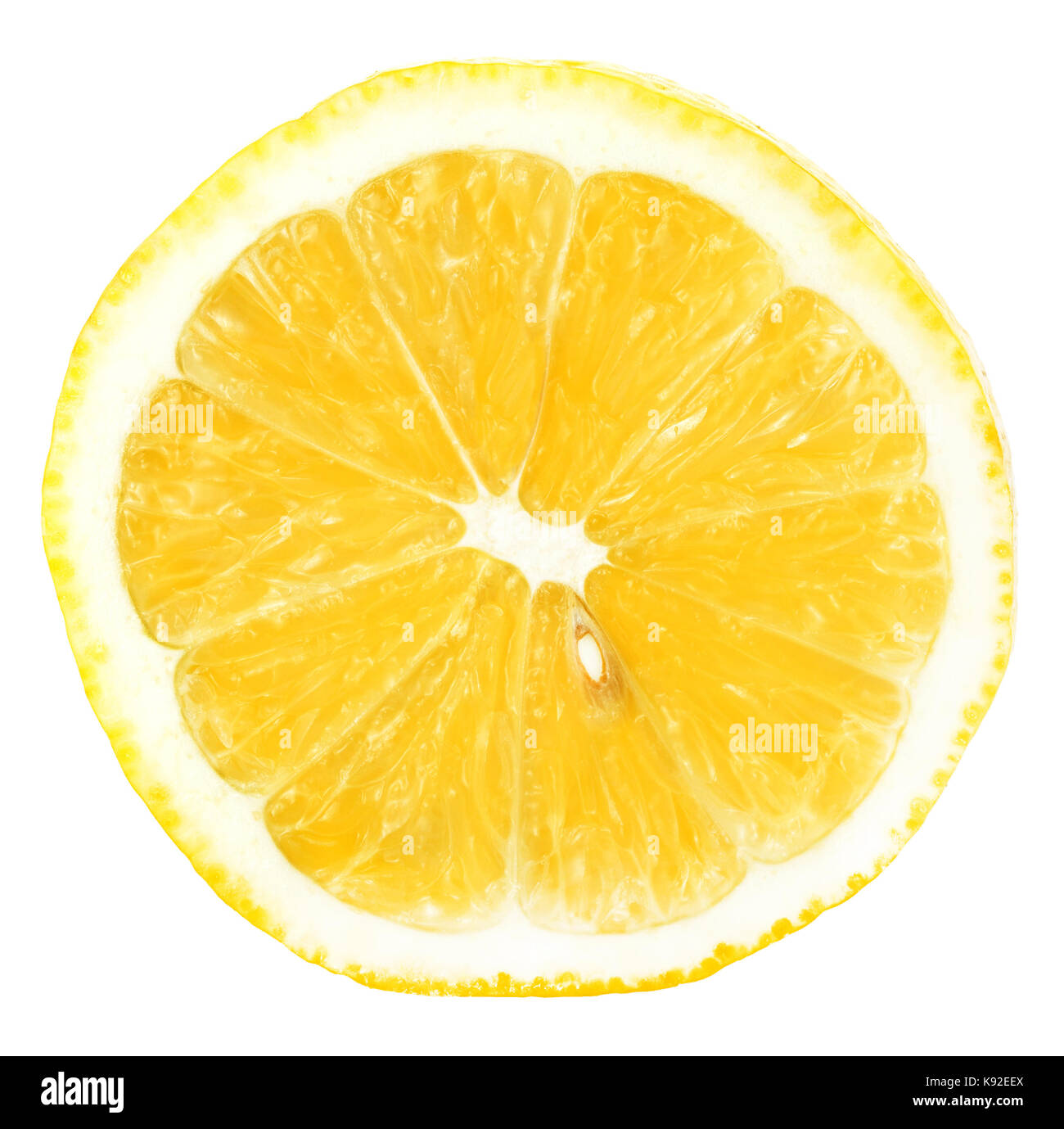 Juicy yellow slice of lemon isolatedon a white background - Stock Image
