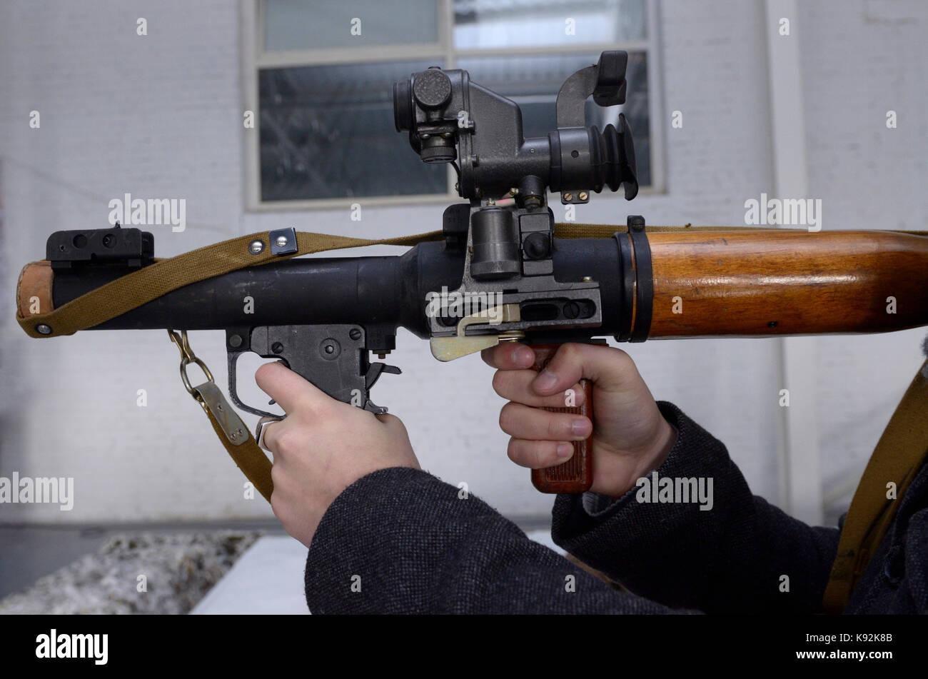Hands holding a rocket-propelled grenades - Stock Image