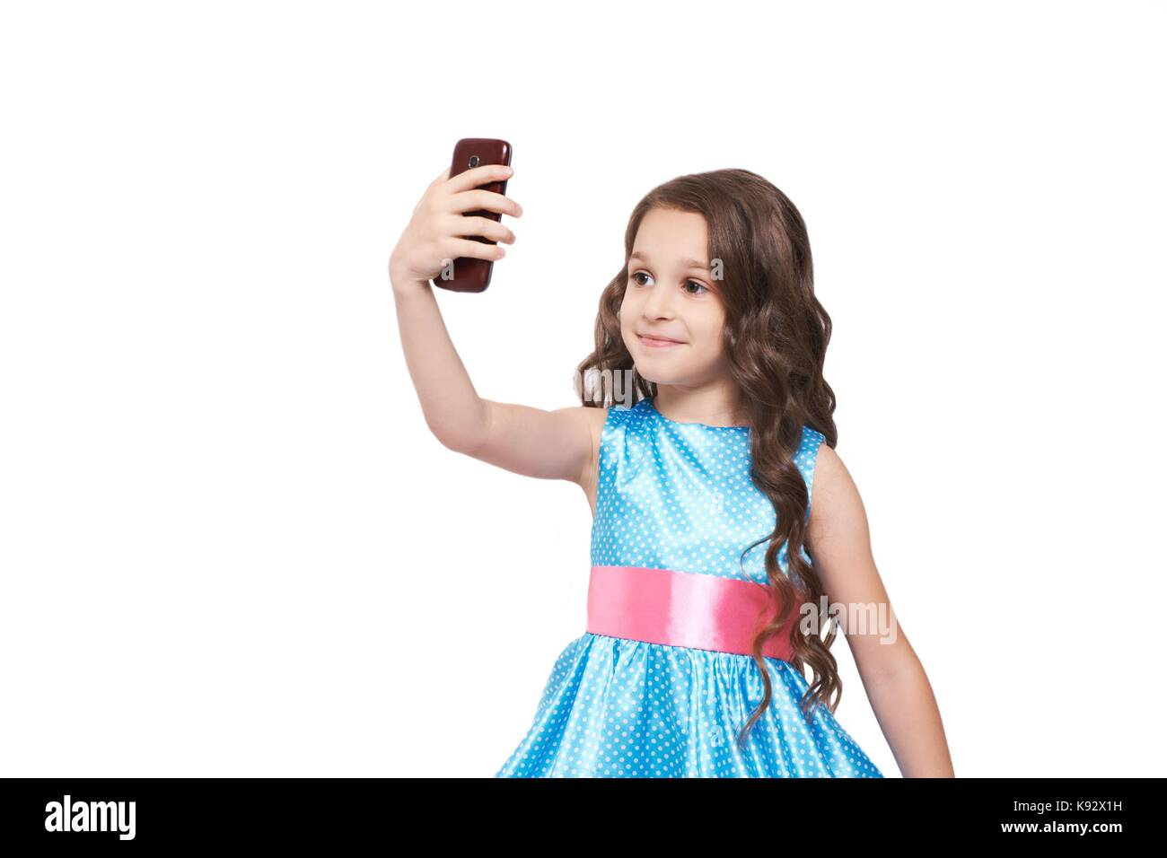 785aa8227 Portrait. Girl. Selfy. Cute baby. White background. Blue dress Stock ...