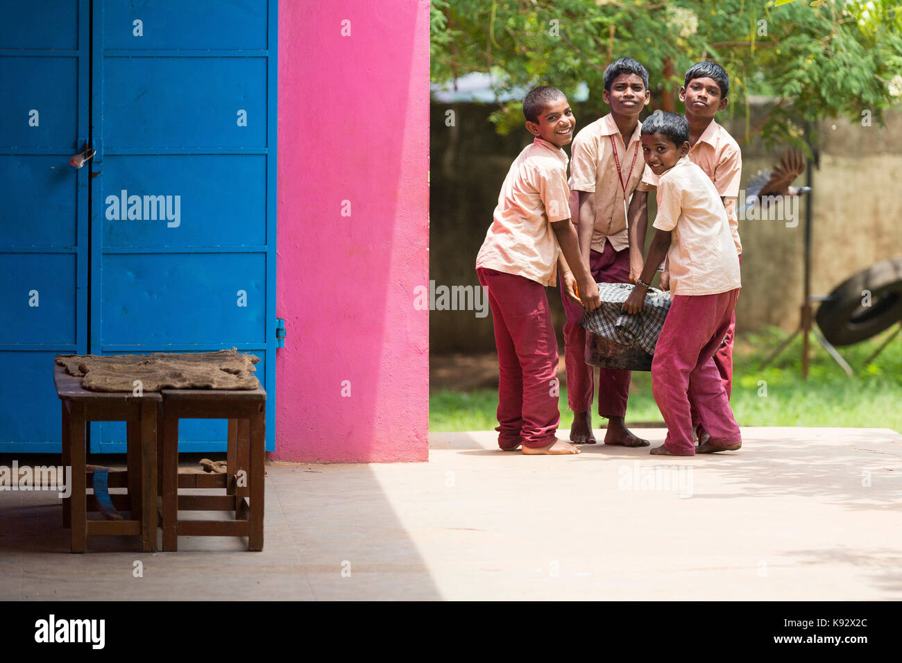 PONDICHERY, PUDUCHERY, INDIA - SEPTEMBER 04, 2017. Unidentified boys children bring the plate to be served at the Stock Photo