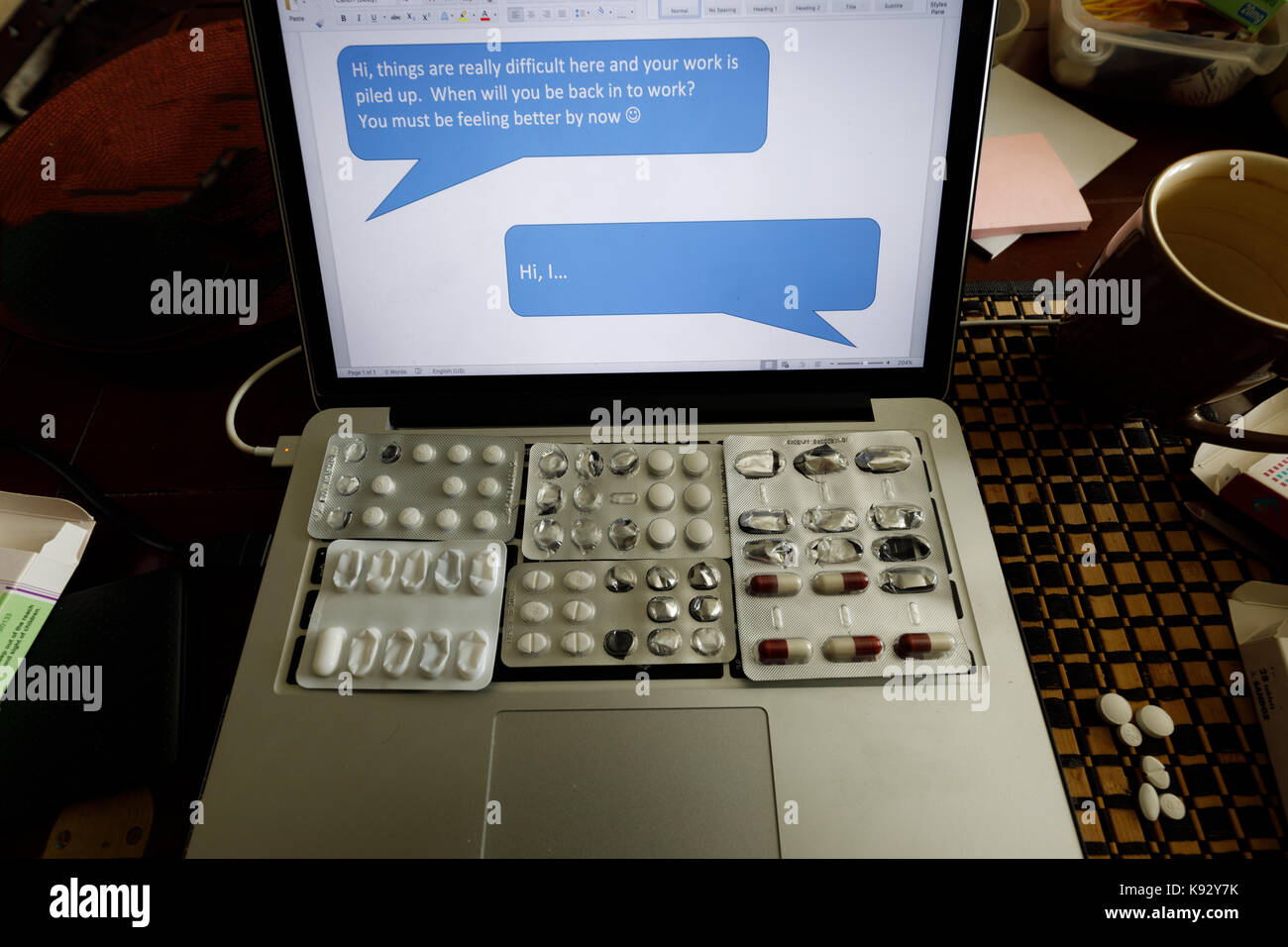 Computer keys covered by pills. metaphorical block to replying to message, sick leave perceptions - Stock Image