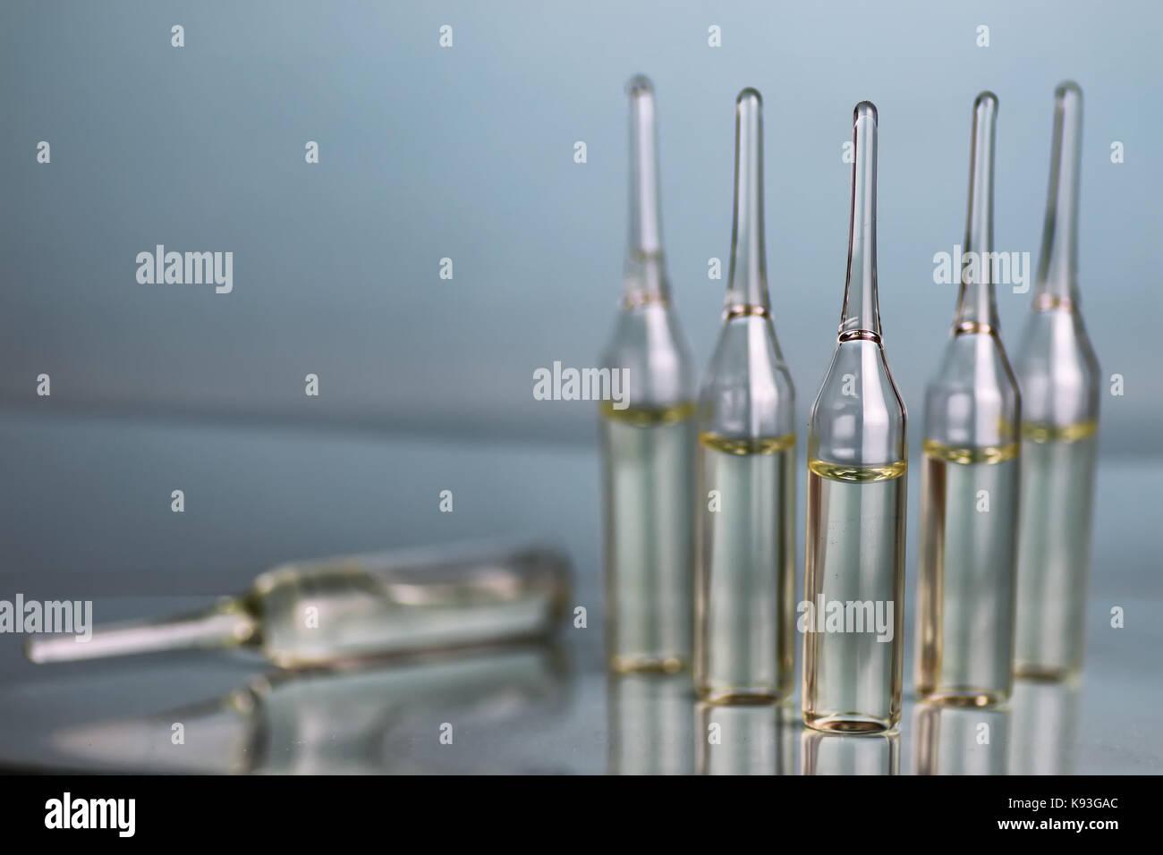 transparent vials of medicine - Stock Image