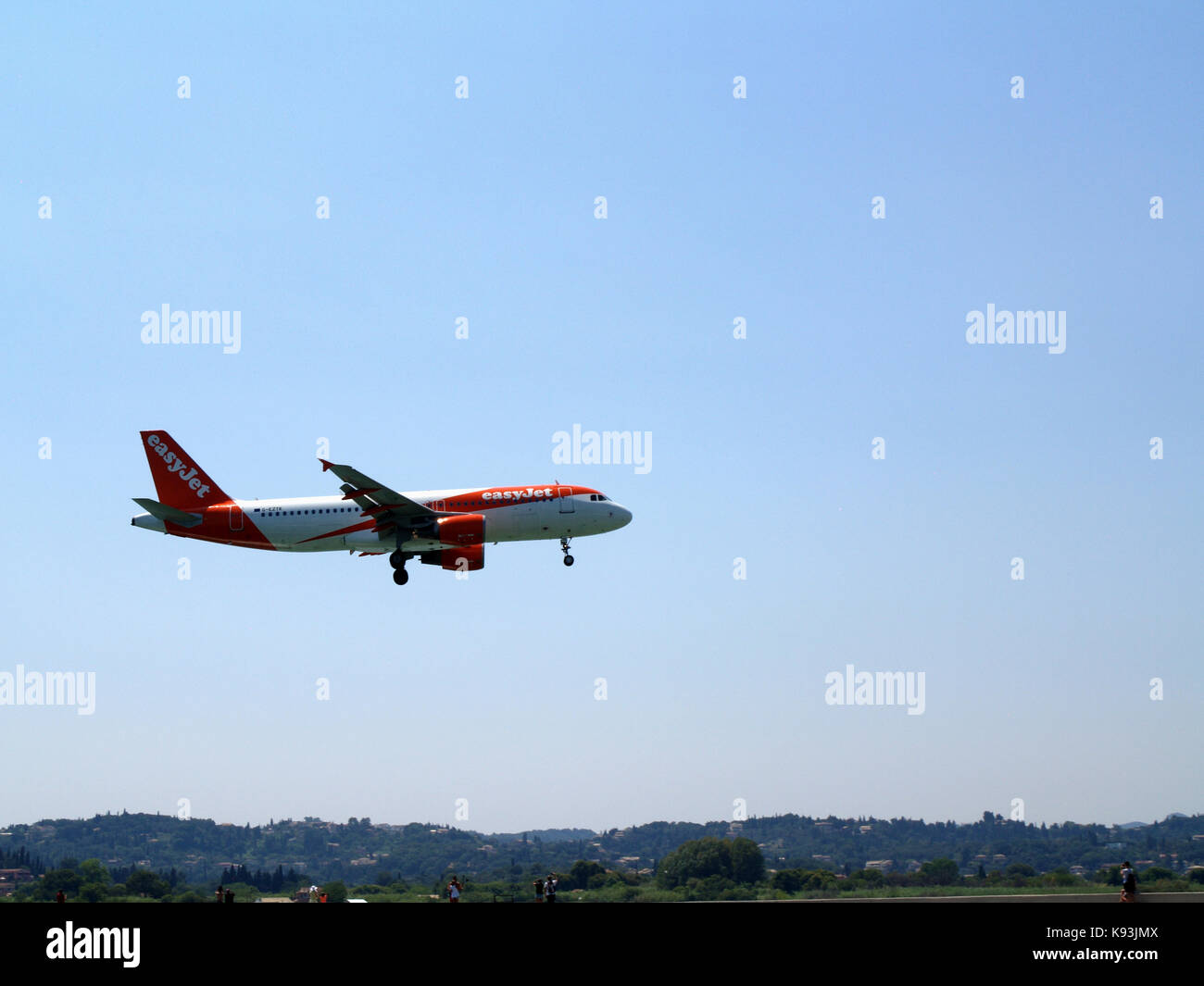 Easyjet airlines Airbus A320-214, flight number G-EZTK landing off at Ioannis Kaposistrias airport Corfu, Greece - Stock Image
