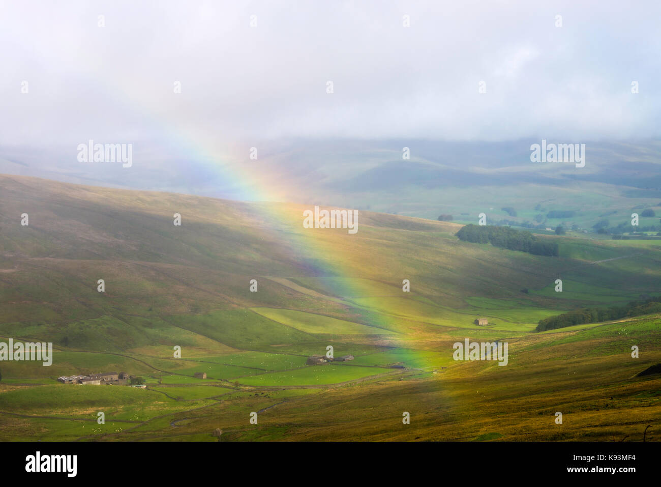 A Beautiful Rainbow in Yorkshire Dales Moorland Above Gayle in Remote Countryside near Hawes North Yorkshire England - Stock Image
