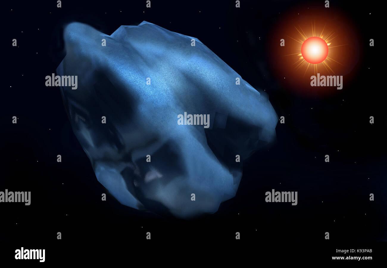 A Comet Orbiting The Sun - Stock Image