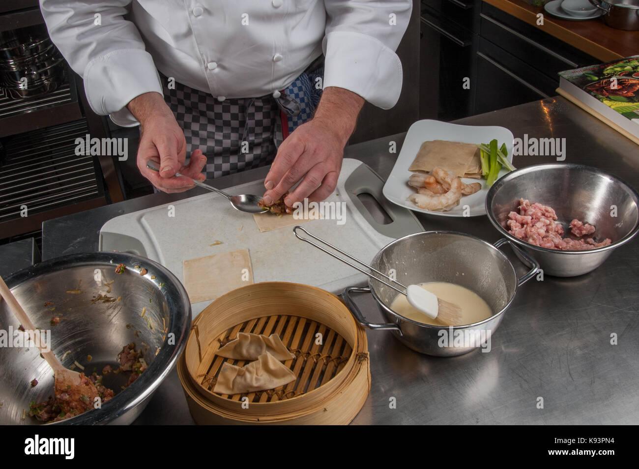preparation of Dim Sum, Restaurant Allegria, Chef Alexander Tschebull, Hamburg, Germany - Stock Image