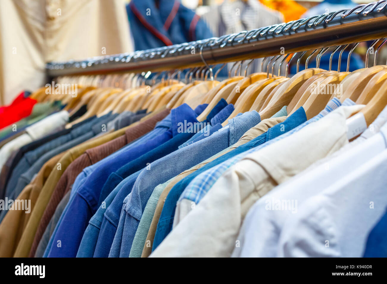 Rail of second-hand clothes on display at Old Spitalfields Market in London Stock Photo