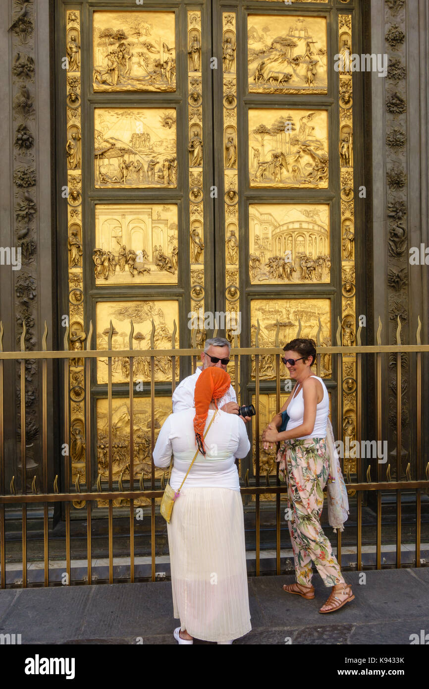 People , tourists in front of the Doors of Paradise in Battistero di San Giovanni, Florence, Italy. - Stock Image