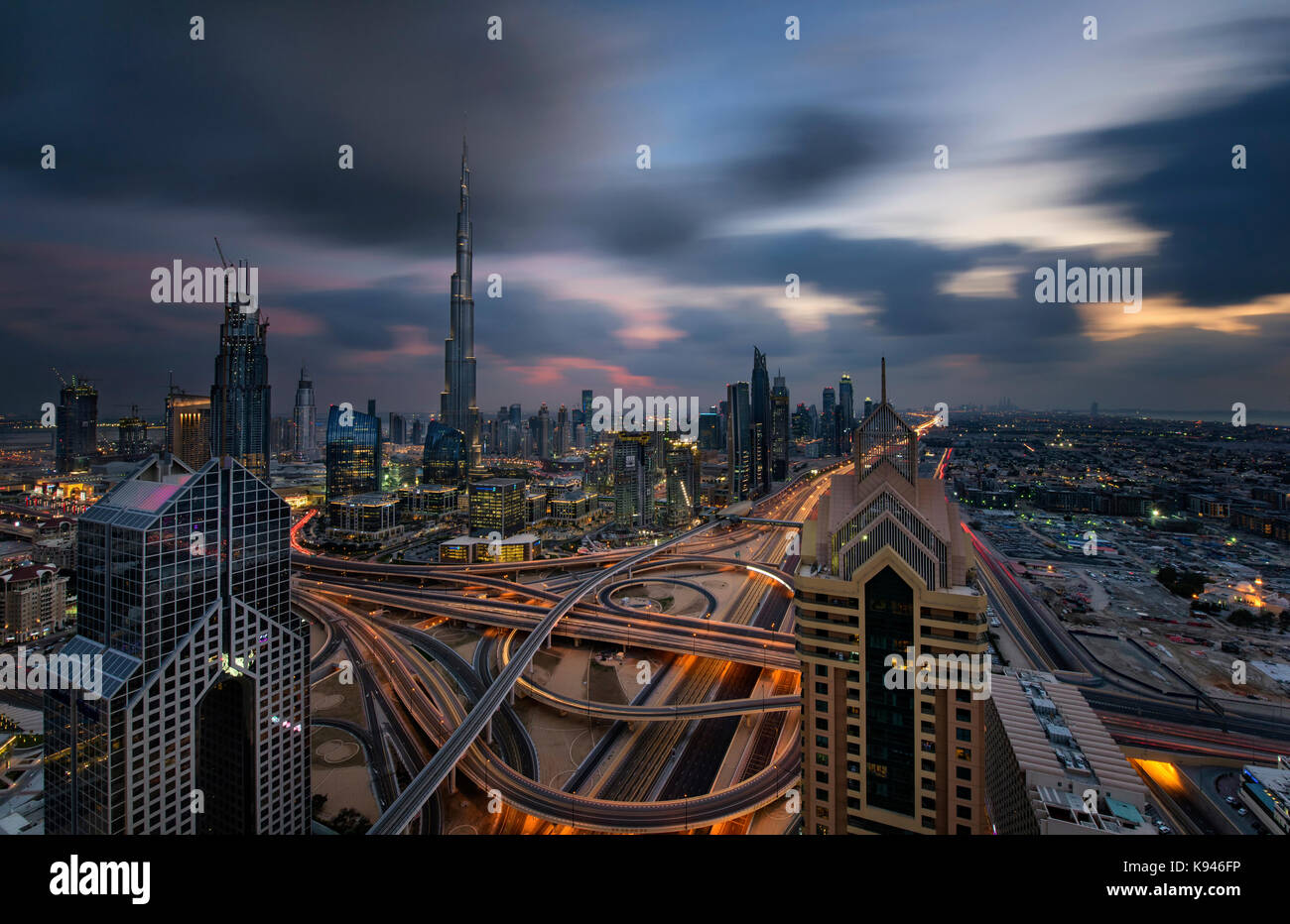 Cityscape of the Dubai, United Arab Emirates, with the Burj Khalifa and other skyscrapers under a cloudy sky. - Stock Image