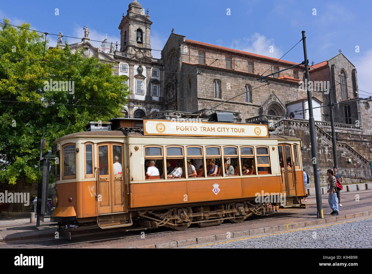 Porto city tour traditional tram and São Francisco church Porto Portugal Stock Photo