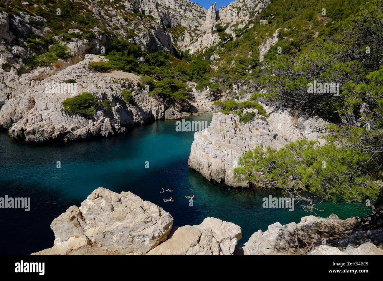 Swimmers at The Calanques on the coast of the Mediterranean near Marseilles, Provence, France - Stock Image