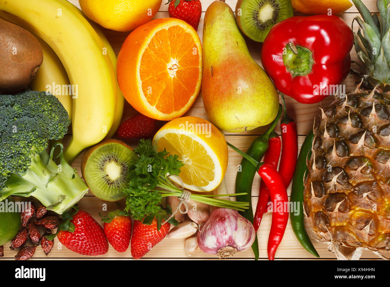 Vitamin C in fruits and vegetables. Natural products rich in vitamin C as oranges, lemons, dried fruits rose, red - Stock Image