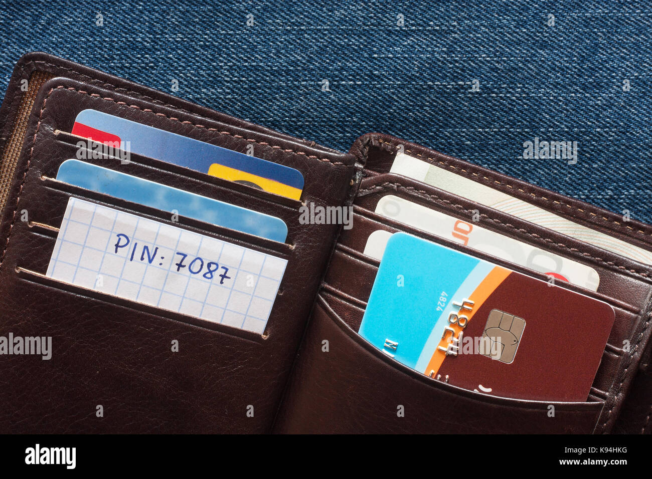 Credit card with pin number in wallet on blue background - Stock Image