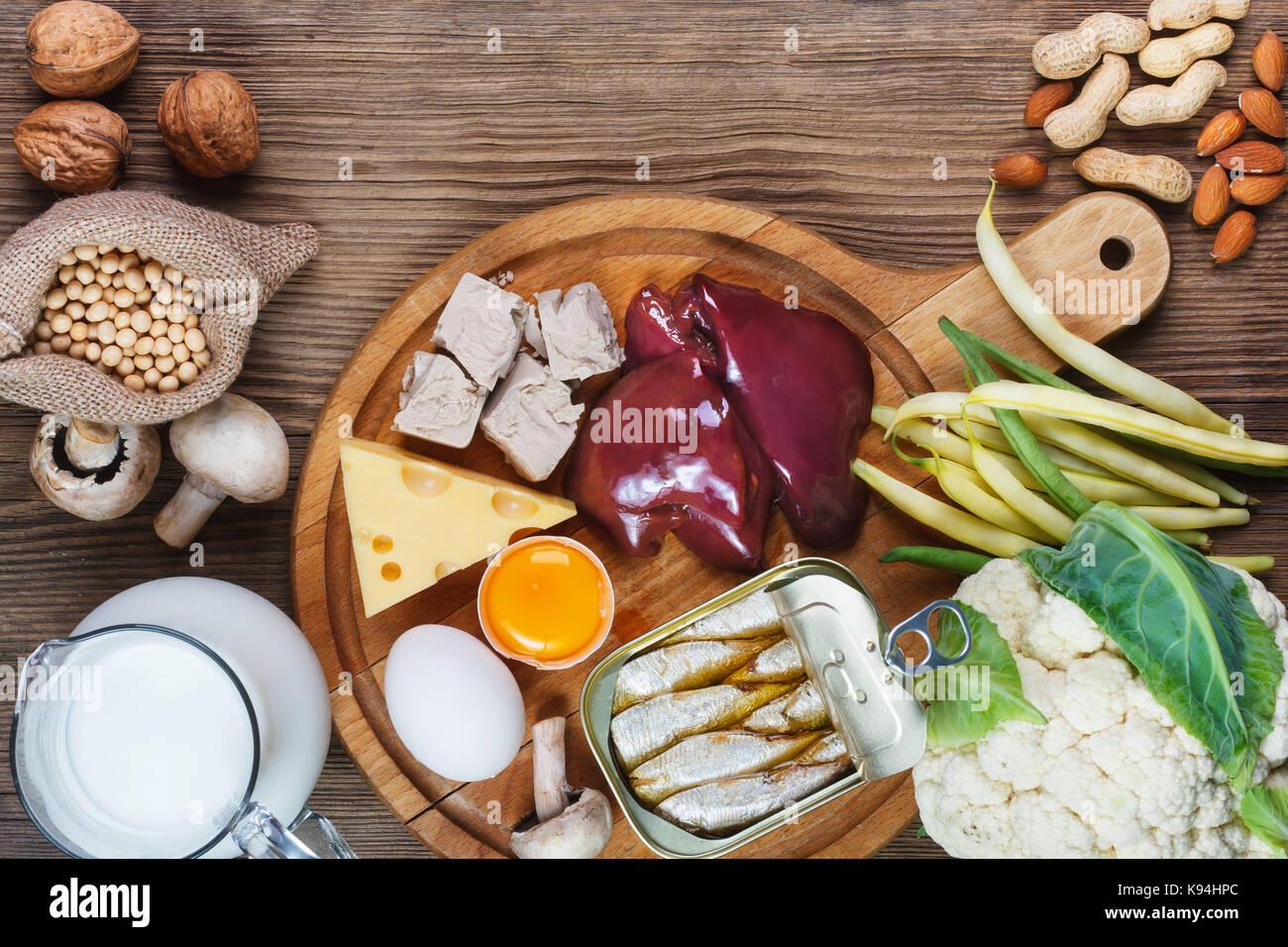 Foods rich in Biotin (vitamin B7). Foods as liver, eggs yolk, yeast, cheese, sardines, soybeans, milk, cauliflower, - Stock Image