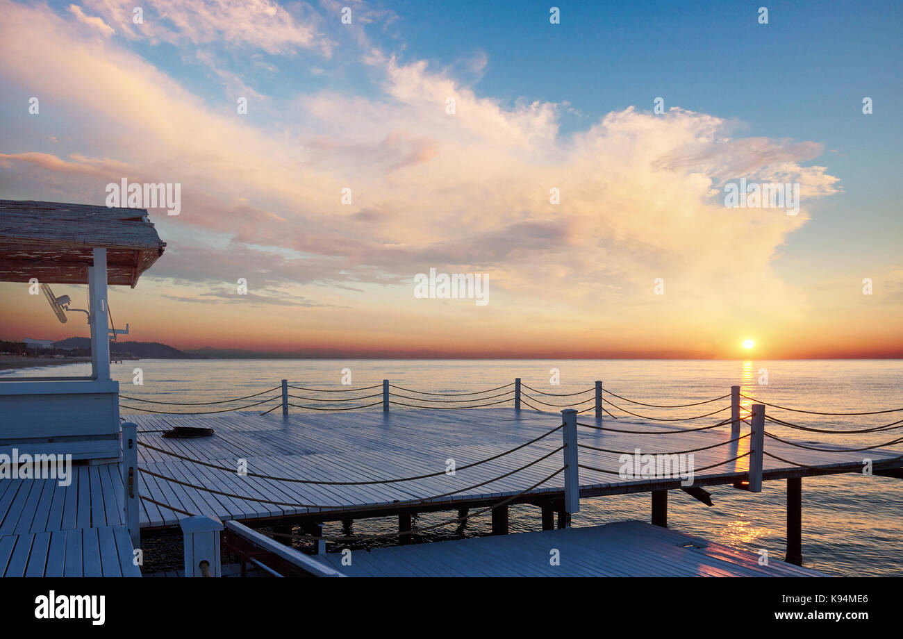 Good views of the White Pier at sunset, which is used for natural background sea - Stock Image
