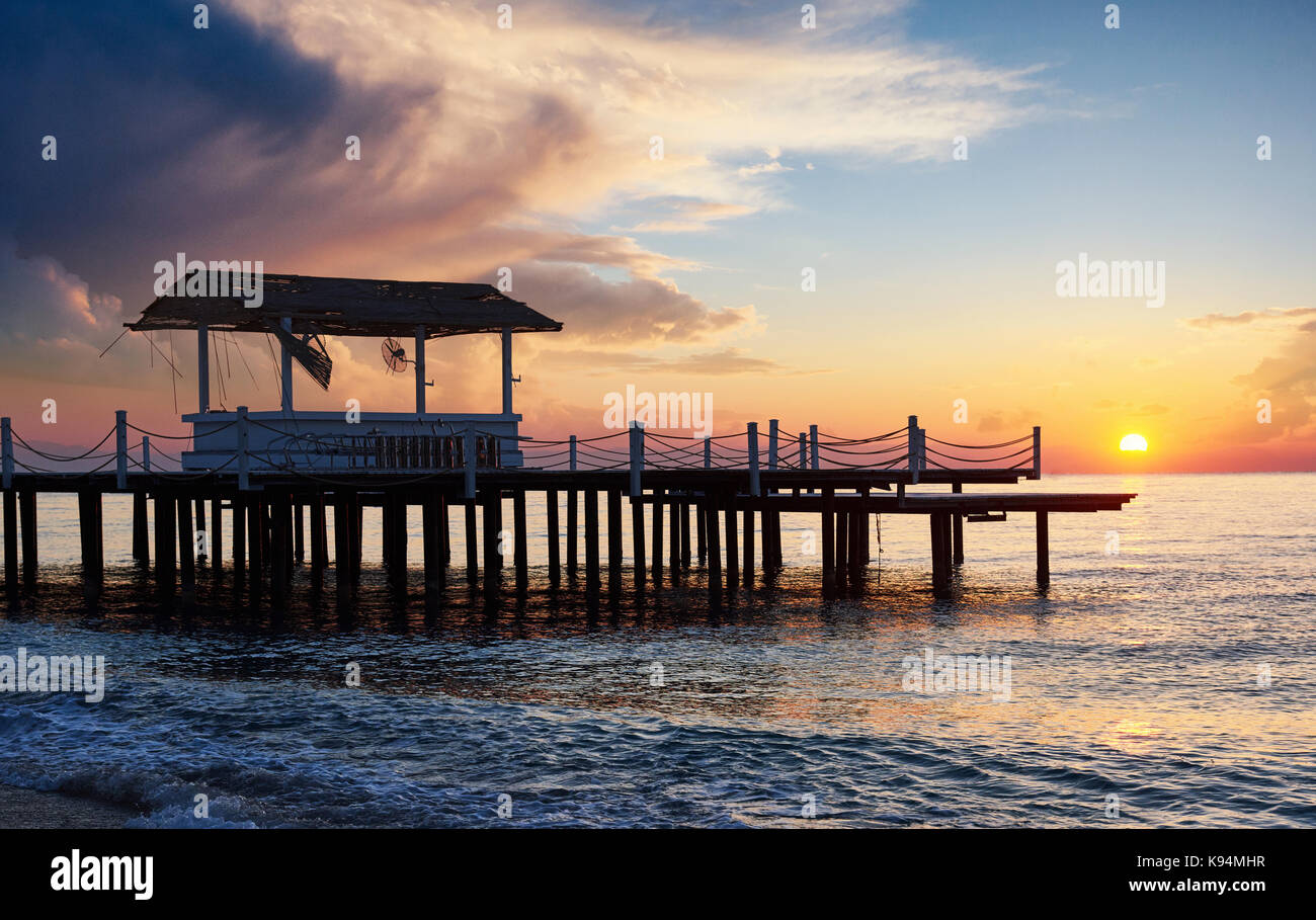 Romantic view of the pier at sunset used for natural background Sea. - Stock Image