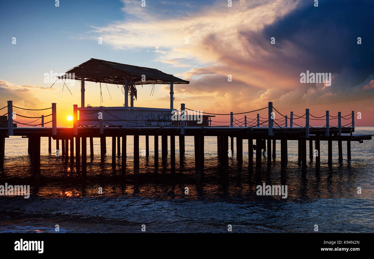 Wooden bridge pier against a beautiful sky measure used for natural background, background and multi-stage sea. - Stock Image