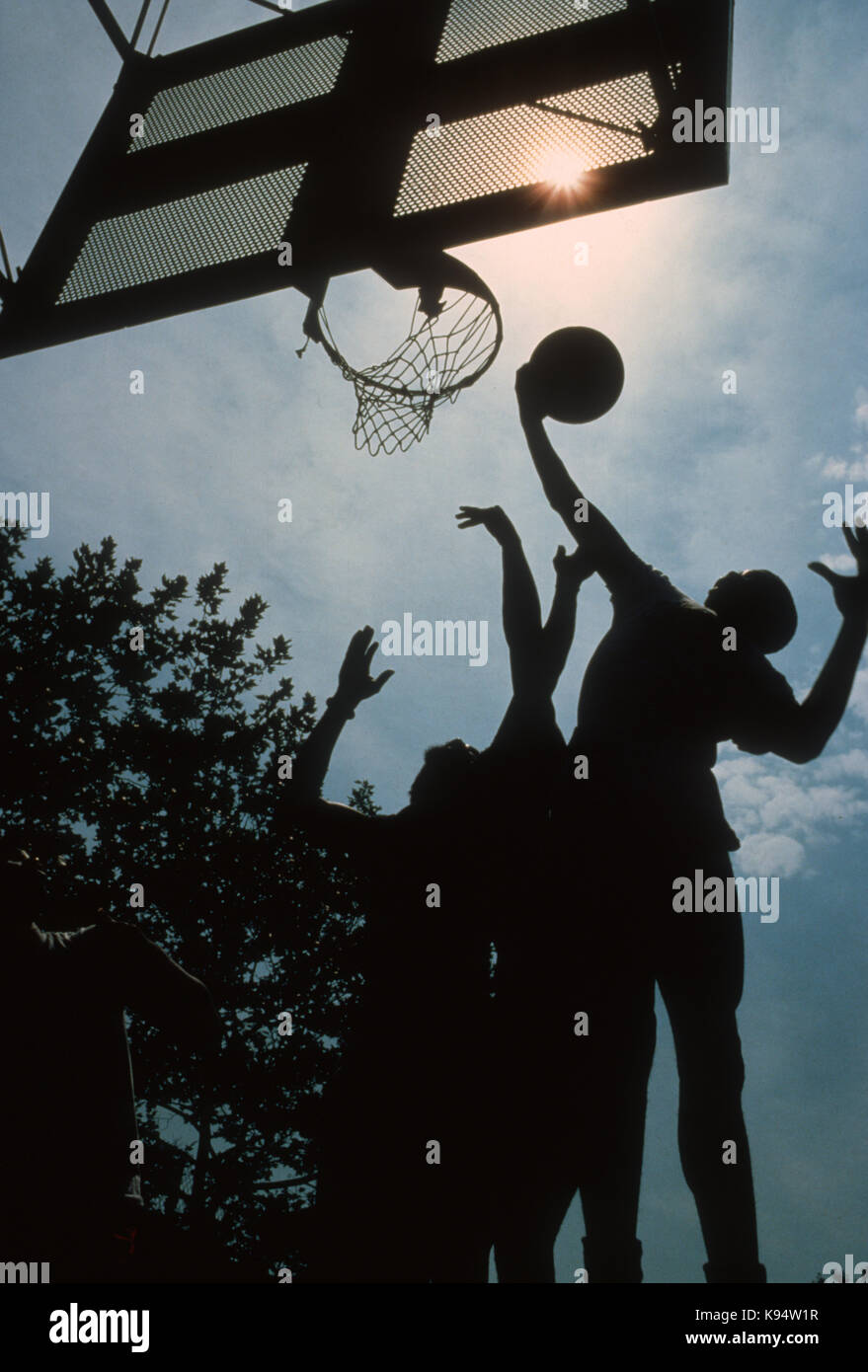 """Players fighting for a rebound during street basketball game in """"the cage"""" in New York City's Greenwich Village, Stock Photo"""