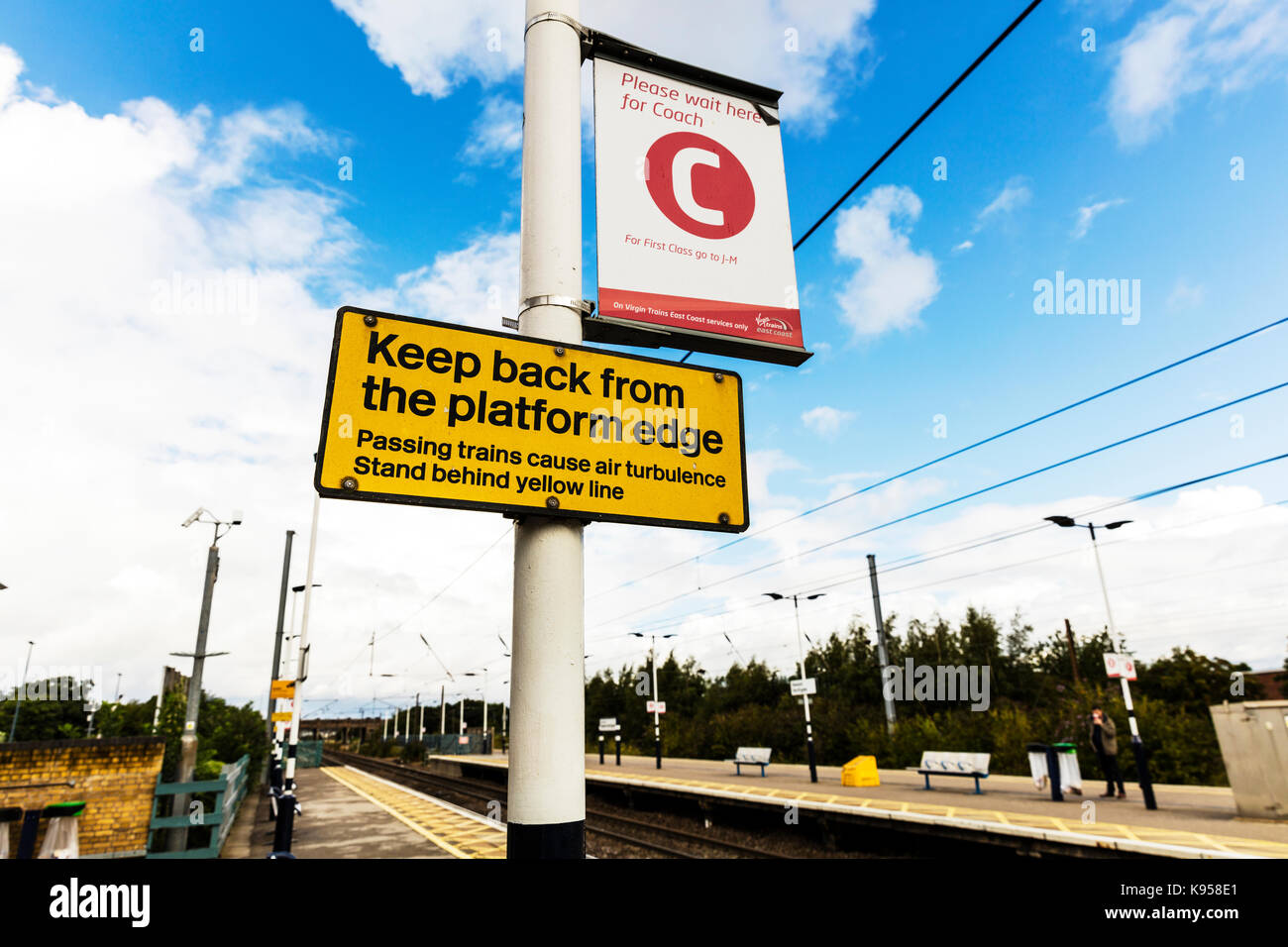 Train warning sign, train station warning sign, trains cause air turbulence sign,  passing trains danger sign, stand - Stock Image