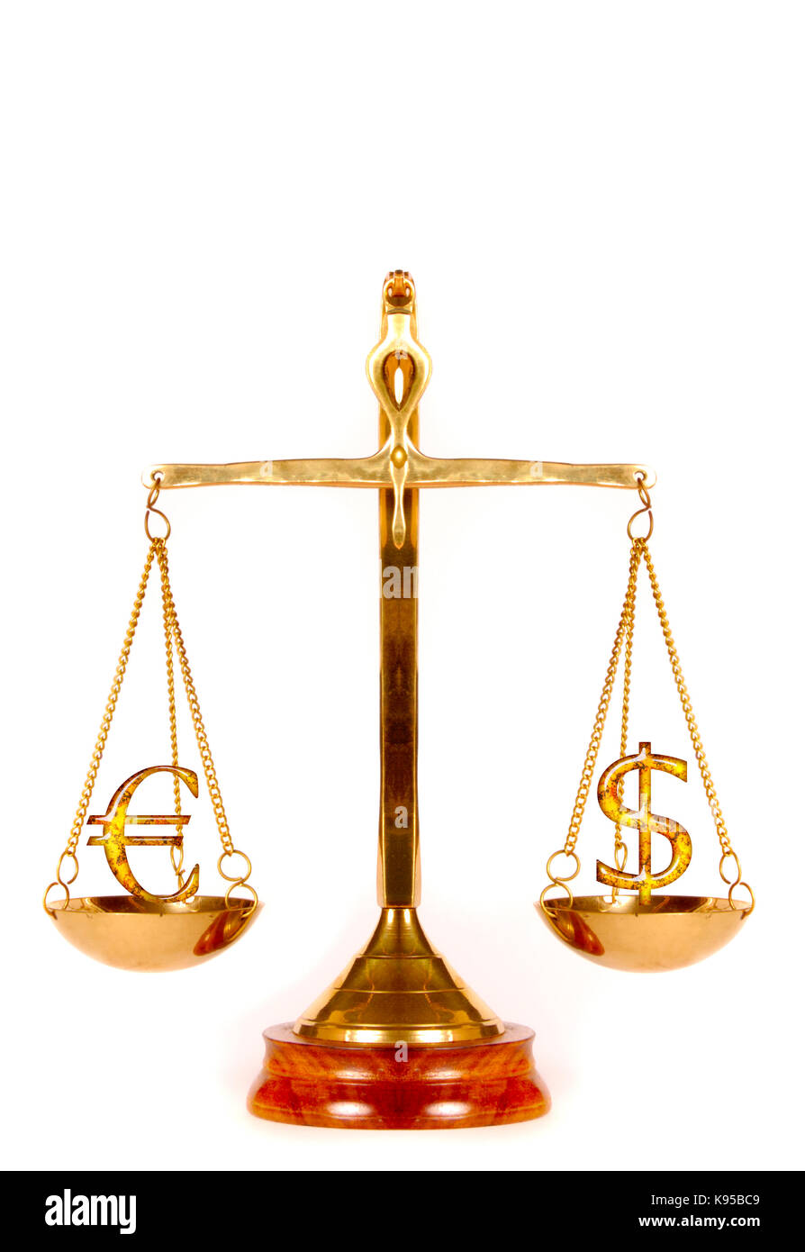 Euro and Dollar symbols on a weighing scale Stock Photo