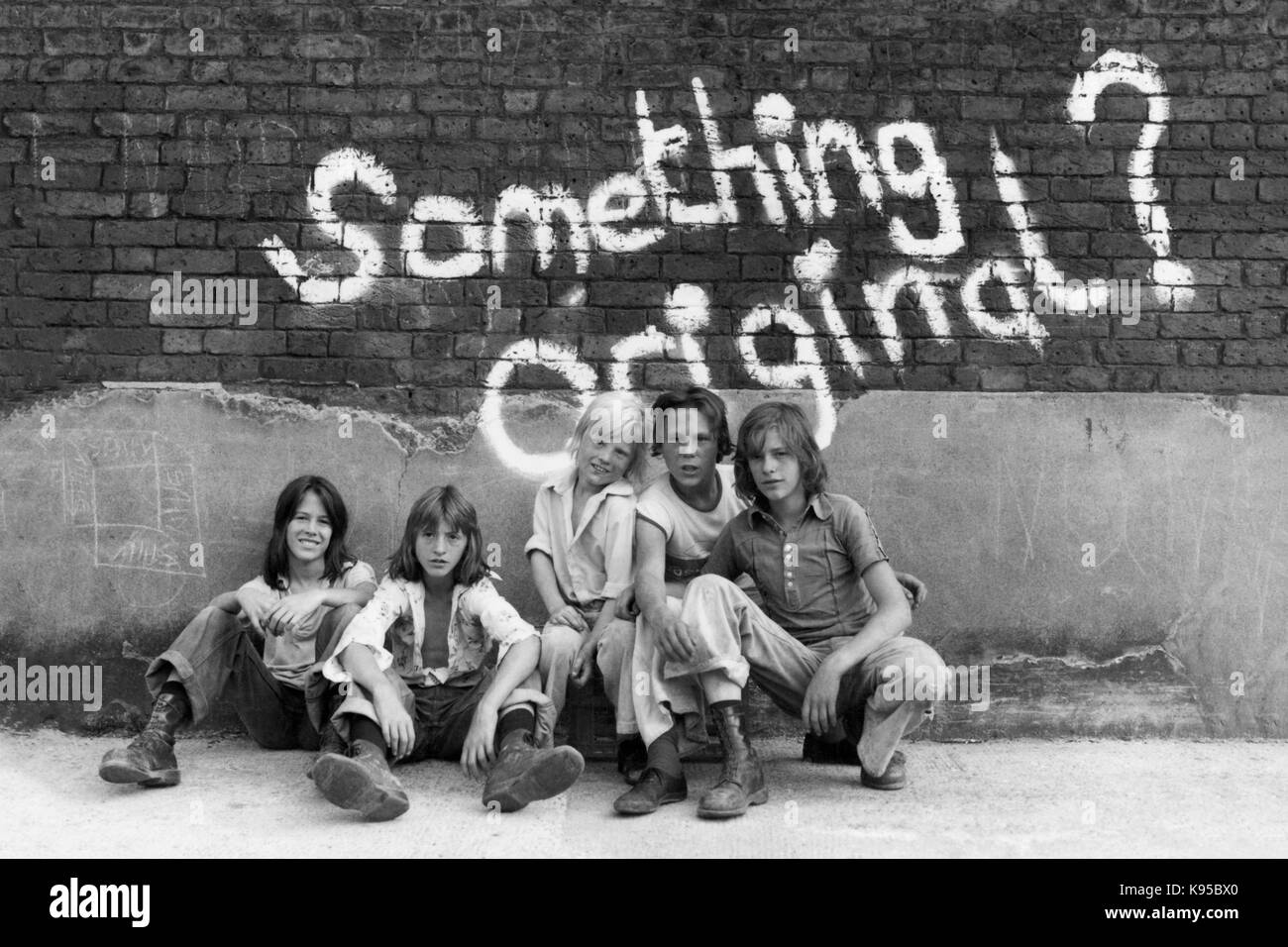 Street Boys Against a Wall of Graffiti - Something Original - 1976 - Stock Image