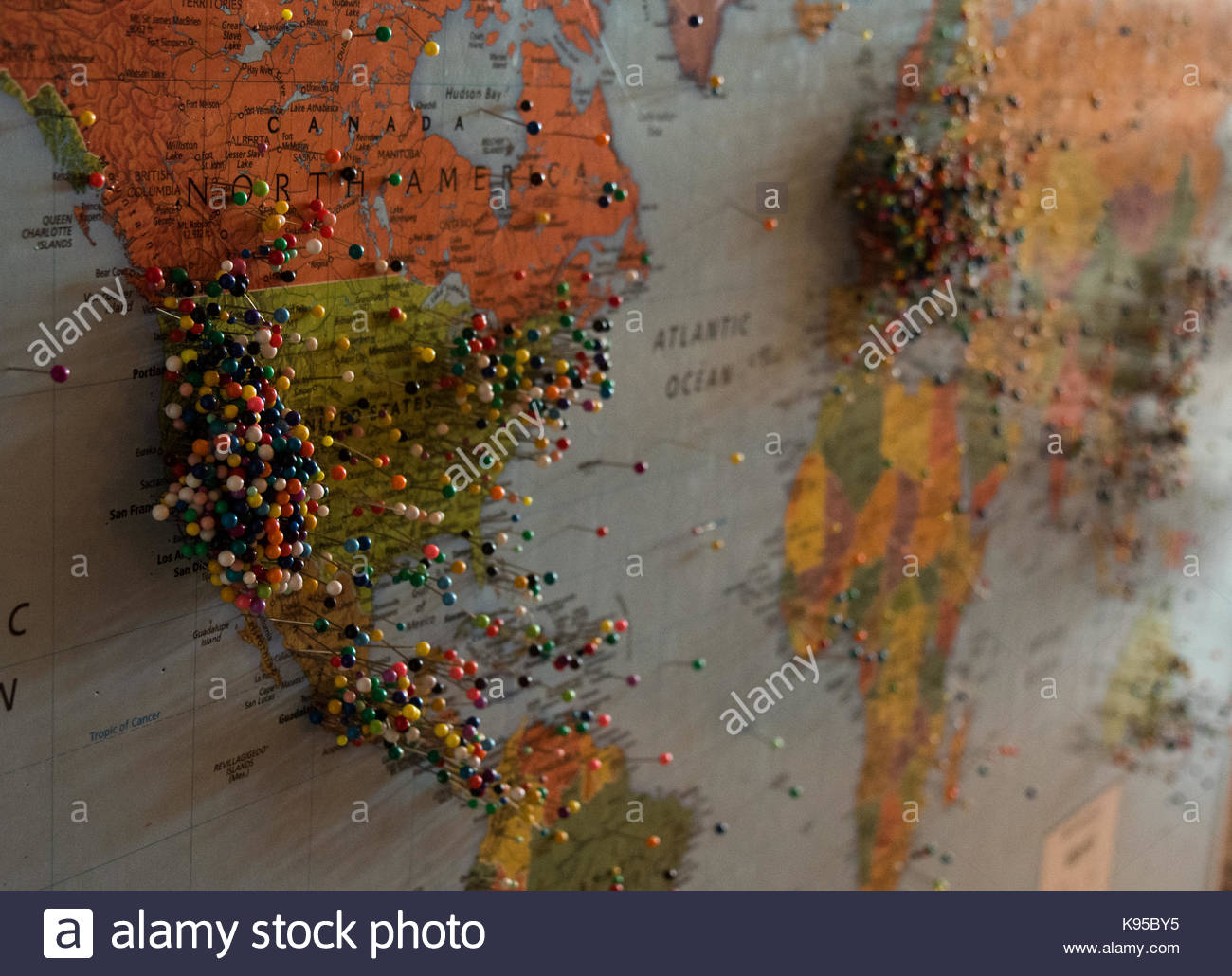 colored pins in a map showing where vistors have traveled from stock image