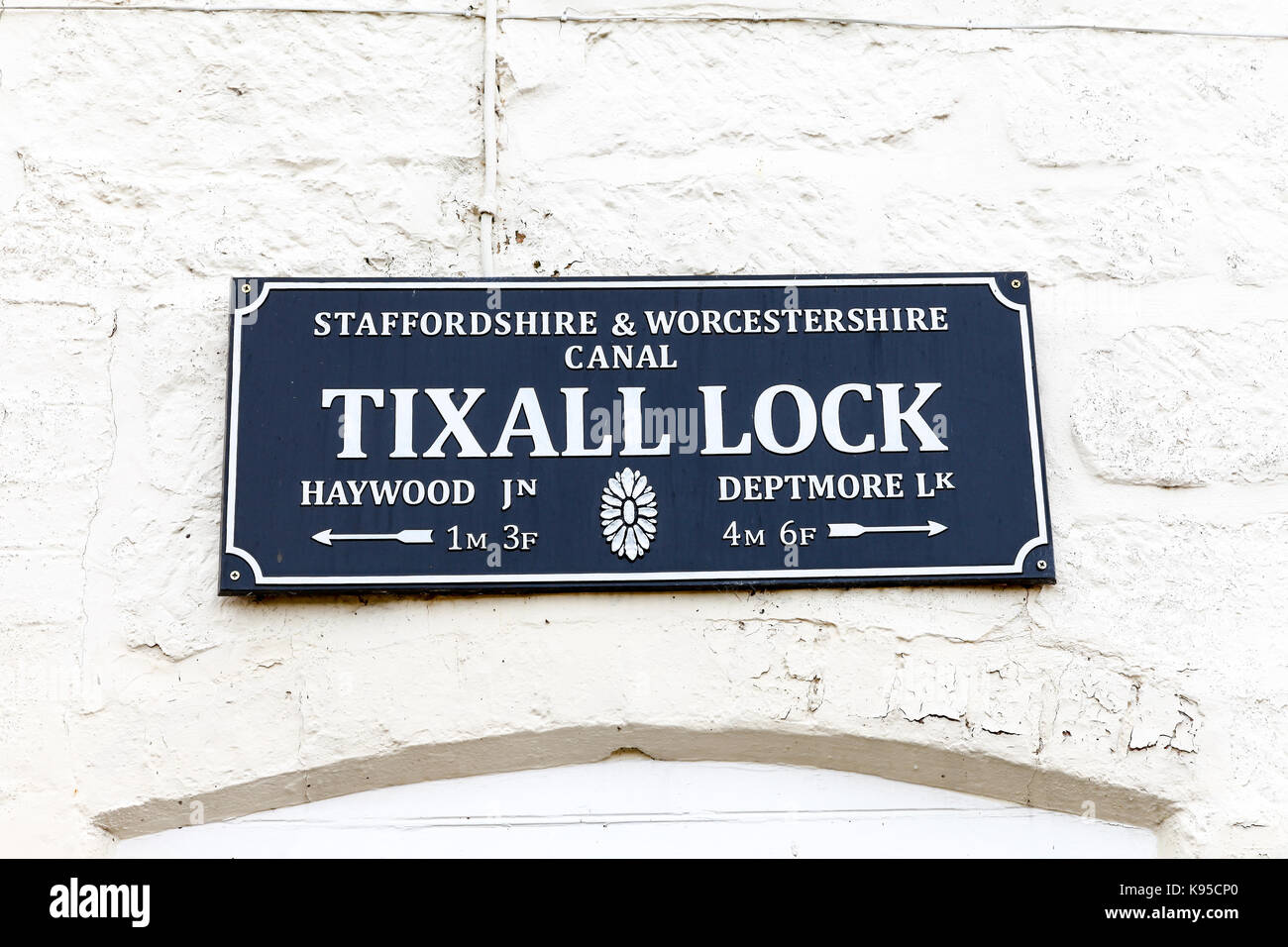 A sign saying Tixall lock on the Staffordshire and Worcestershire Canal near to Tixall, Stafford, Staffordshire, Stock Photo