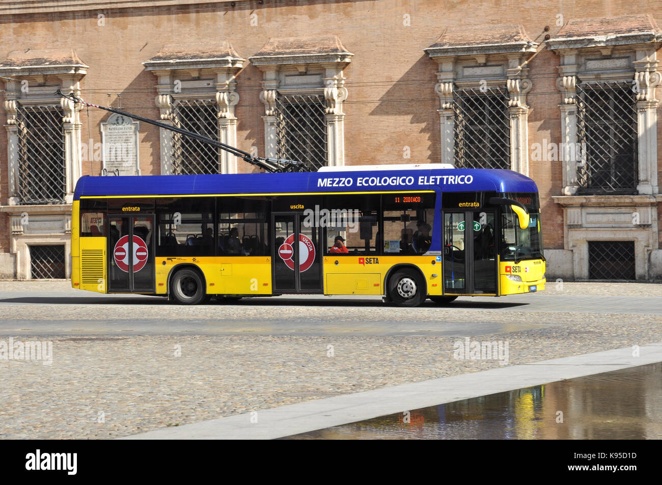 Trolleybus in front of Palazzo Ducale (Ducal Palace), Piazza Roma, Modena, Italy - Stock Image