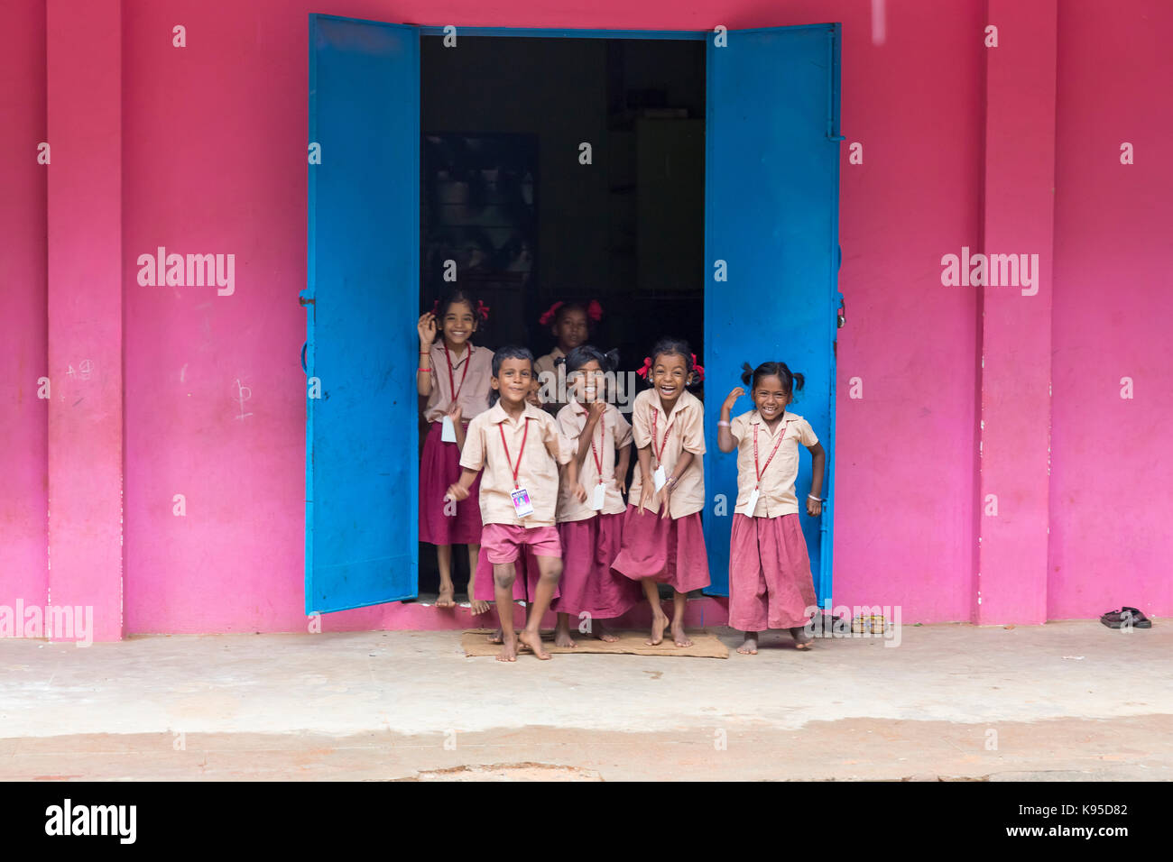 PONDICHERY, PUDUCHERY, INDIA - SEPTEMBER 04, 2017. Pink and blue school with happy chidren with uniforms near the Stock Photo