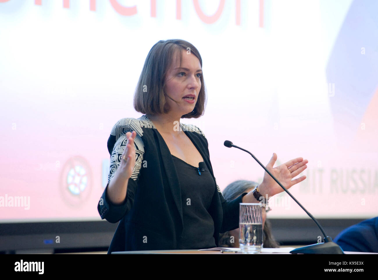 Julia Ioffe speaks from the Starr Forum podium at MIT. Tonight's speakers: Co-chair Elizabeth Wood. Garry Kasparov, - Stock Image