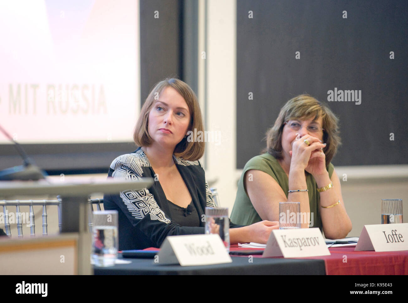 Julia Ioffe and Carol Saivetz look on as Russian dissident Garry Kasparov speaks from the Starr Forum podium at - Stock Image