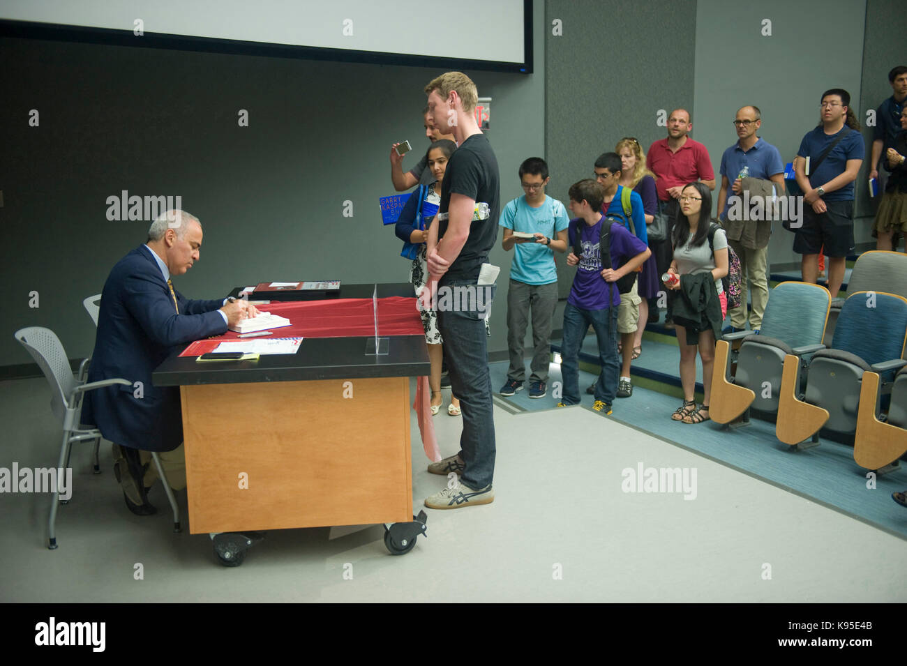 Anti-Putin Russian dissident Garry Kasparov signs his book 'Winter is Coming' at the Starr Form at MIT. - Stock Image