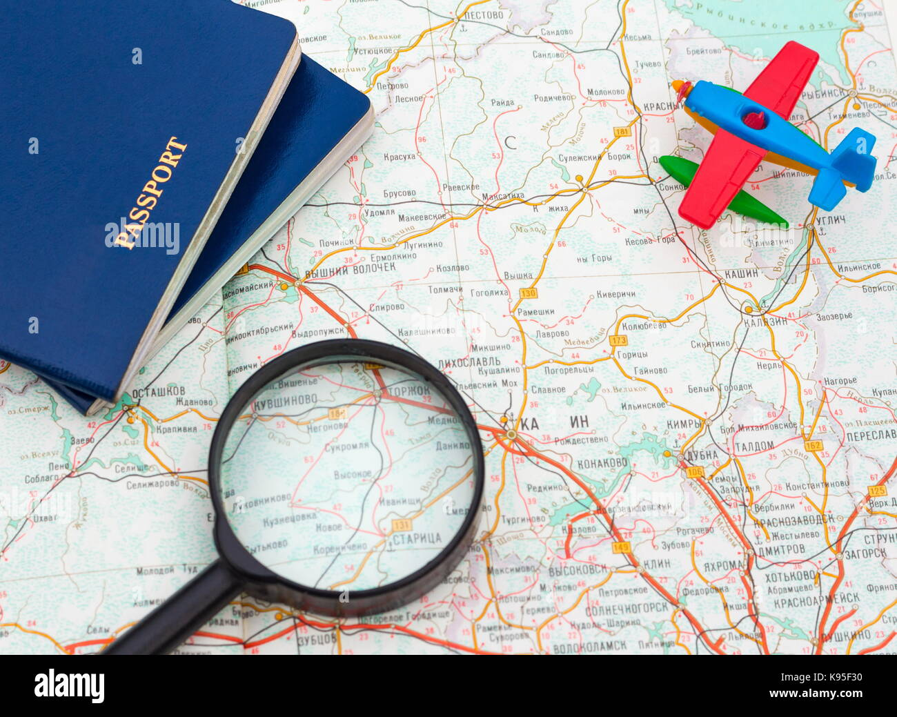 Miniature Airplane Passport And Magnifying Glass On Map Travel Around The World Wallpaper